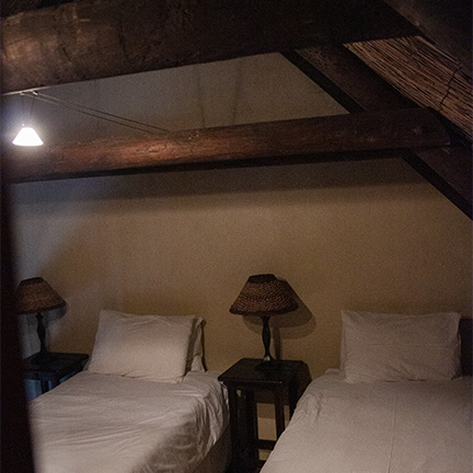 Two upstair twin beds in the cosy loft family apartment at Reeds Country Lodge