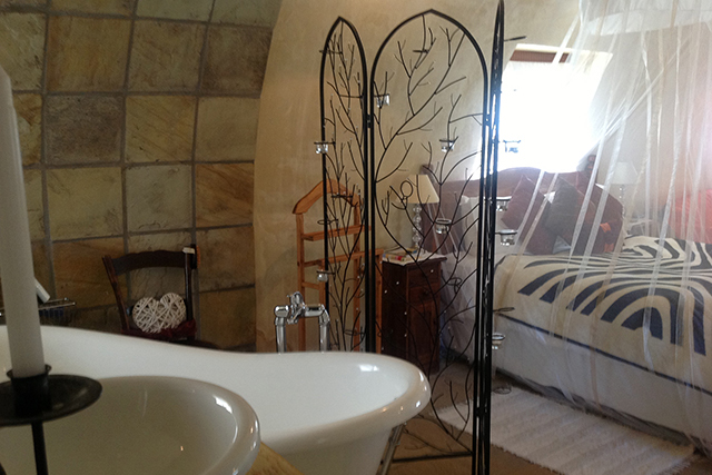 Honeymoon Hut inside view with Victorian bath and cosy atmosphere at Reeds Country Lodge Wedding Venue
