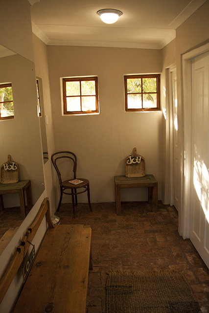A chair and bench create atmosphere in the beautiful dormitory bathroom facilities at Reeds Country Lodge