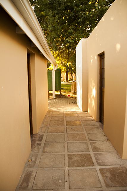 A passage with an entrance to the the dormitory conveniently right across from the entrance of the public bathroom.