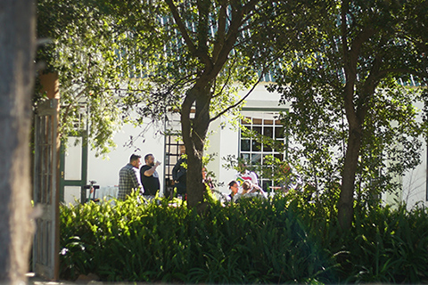 Conferences and group accommodation with a group having lunch under the trees at conference venue Reeds Country Lodge